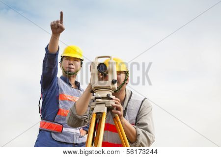 Surveyor engineer making measure with partner