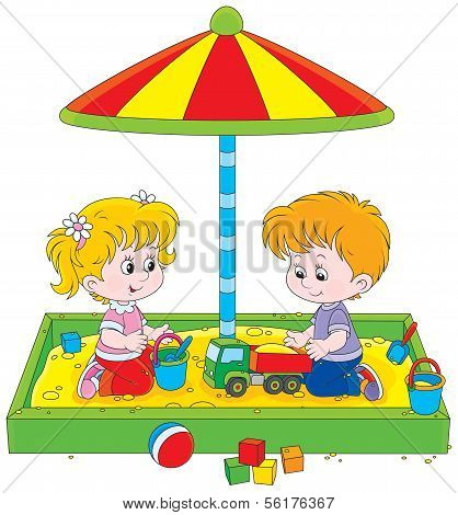 Children play in a sandbox