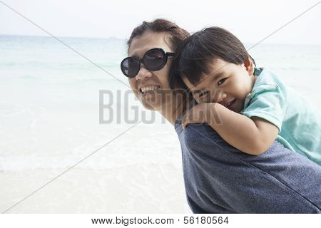 mother and kid relaxing emotion on sand beach use for good healthy lifestyle single mom and family t