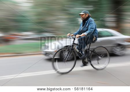 Cyclist And A Car On The Streets Of New York