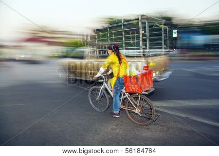 Lady Drives Home With Bike In Early Morning From The Flower Market