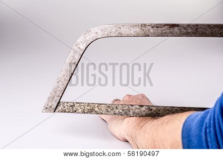 Close Up Of A Suicidal Man Hand On Isolated White Background With Saw