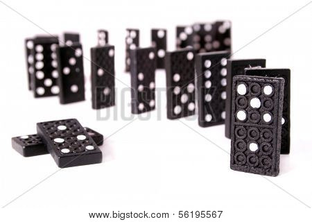 A line of black dominoes. All isolated on white background.