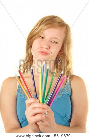 An attractive young woman chooses a colored pencil. All on white background.