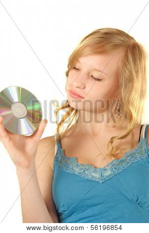 An attractive young woman holding a cd or dvd. All on white background.