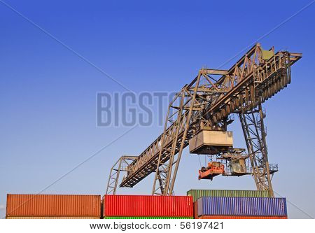 Typical industrial harbor scene in front of a blue sky.
