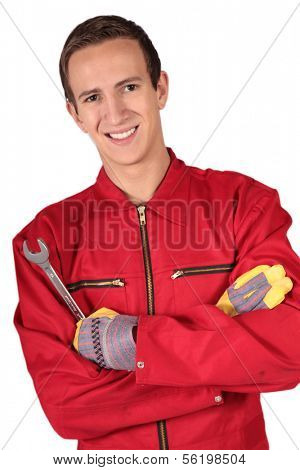 A young mechanic trainee. All isolated on white background