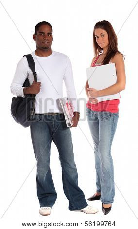 Two attractive students standing in front of plain white background.