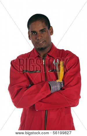 An attractive dark-skinned worker. All on white background.