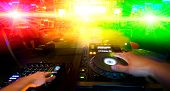 image of disc jockey  - photo disc jockey with sound control desk - JPG