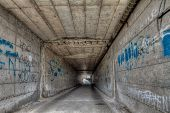 stock photo of reinforcing  - narrow underpass with graffiti  - JPG