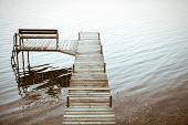 stock photo of dock a pond  - Wooden Dock leading into the water - JPG
