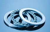 stock photo of ball bearing  - metall glossy ball bearings blue toning idea - JPG