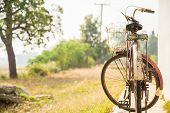 stock photo of house woods  - Old bicycle on the side of the house for background - JPG