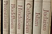 stock photo of spines  - Book spines listing major world religions  - JPG