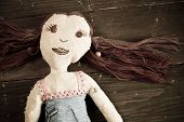 Hand made doll with red hair and a vintage look