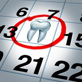 stock photo of visitation  - Dentist appointment and dental check up health care concept as a month calendar with a tooth circled and highlighted as a reminder metaphor for a dentist visit time at a clinic for scheduled oral care - JPG