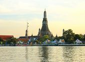 Wat Arun, The Temple Of Dawn, Stands On The Chao Phraya River In Bangkok Thailand