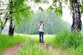 pic of knapsack  - teenager with knapsack get lost in summer forest - JPG