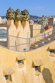BARCELONA, SPAIN - SEPTEMBER 9, 2013: Chimneys on Casa Mila (La Pedrera), building constructed betwe