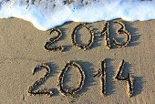 picture of happy new year 2013  - Happy New Year 2014 replace 2013 concept on the sea beach - JPG
