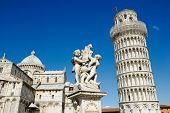 The Pisa Cathedral, The Fountain with Angels, and the Leaning Tower of Pisa in Piazza dei Miracoli i