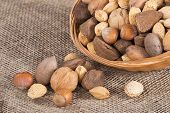 image of brazil nut  - Mixed nut basket with almonds walnuts pecans hazelnuts and Brazil nuts on burlap background - JPG