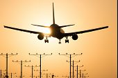 image of lax  - Airplane landing at Los Angeles International Airport during sunset Los Angeles California USA - JPG