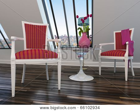 Upholstered antique style wooden armchairs with red upholstery flanking a small table with a vase of red flowers under a sloping window with a sky view