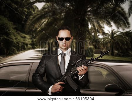 Confident Bodyguard Holding Automatic.
