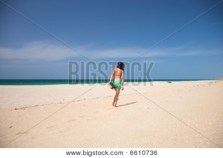 Green Shorts Female Walking On Sand
