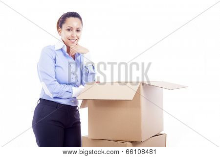 Woman standing with card boxes, isolated on white