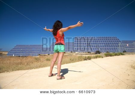 Red Woman Greeting Solar Panels