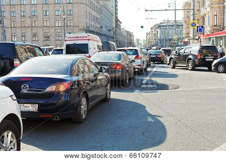 Traffic Congestion On Street In Summer Evening