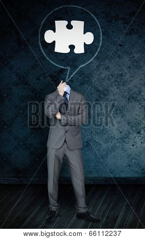 Composite image of headless businessman with jigsaw in speech bubble against dark grimy room