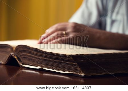 Male Hand On Bible