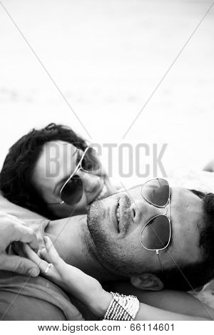 Monochrome shot of a couple at the beach