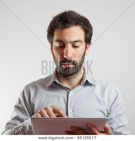 Business man using a tablet computer