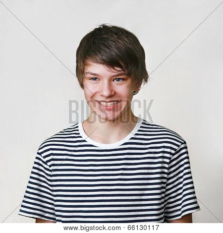Hansome young teenage boy standing and smiling