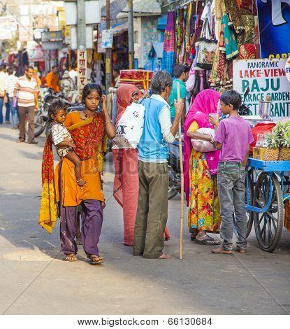 Mother With Child Walks Around Pushkar In The Main Street