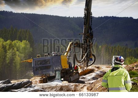 surveyor measuring rock-drilling for dynamiting, civil-engineering