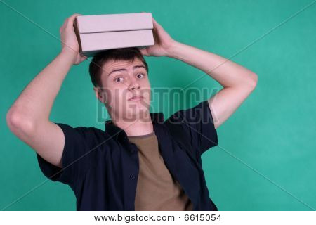 Student with heavy books on his head