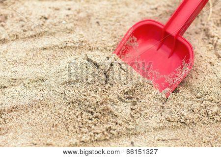 Children's Shovel In The Sandbox.