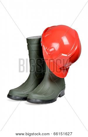 Protection helmet and rubber boots isolated over white with clipping path.