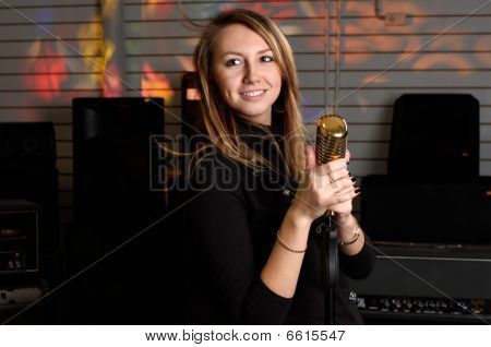 Young Female With Microphone