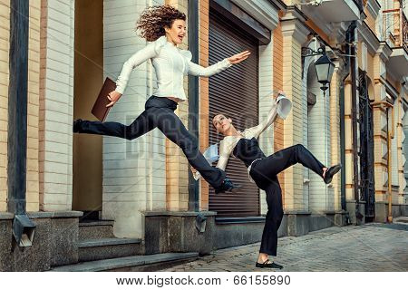 Girl Happily Runs With Office Faced With A Girlfriend.