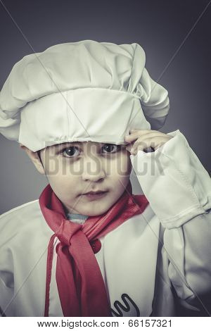 small child dress funny chef, cooking utensils