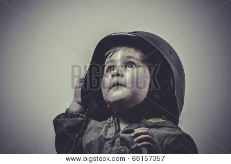 fighter, fun and funny child dressed in military cap, playing war games