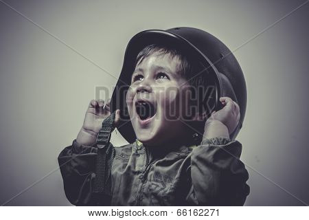 uniform, fun and funny child dressed in military cap, playing war games