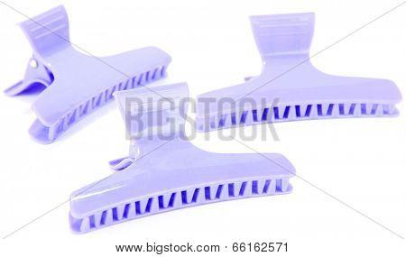 Violet hair-slides isolated on white